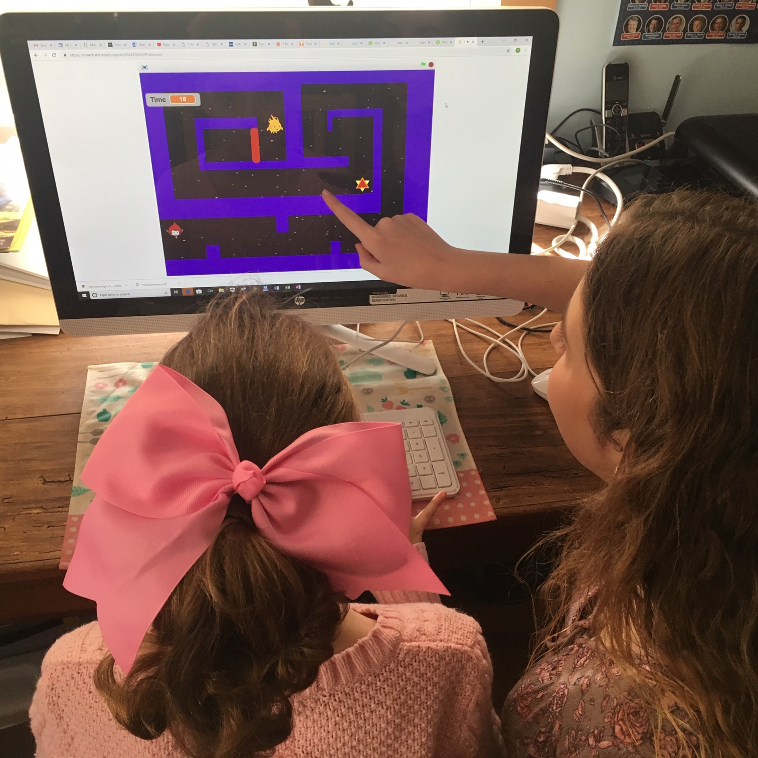 Demonstrating her game from her online Scratch programming class